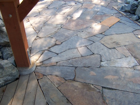 Iron Mountain flagstone radiates from a central post in the lower patio